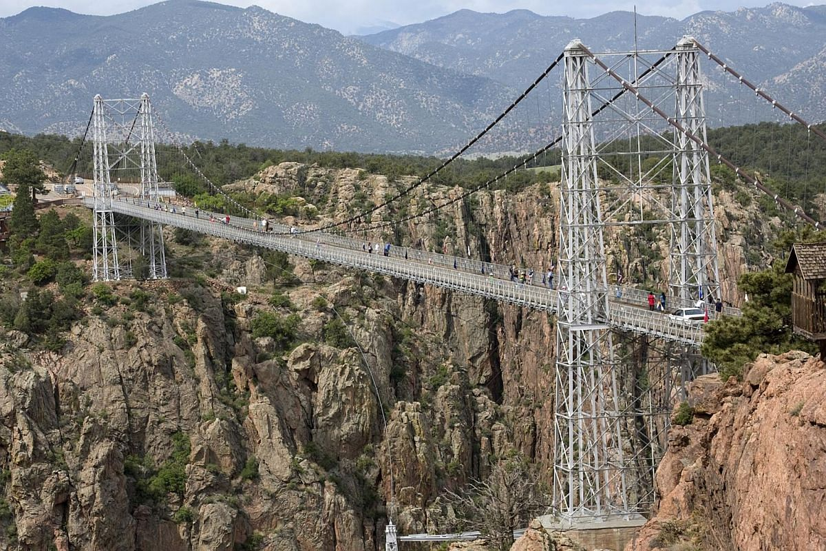 The Royal Gorge Suspension Bridge  in Colorado, US,  spans across 286m in length. The bridge is 384m long and 5.5m wide, with a wooden walkway with 1,292 planks. The bridge is suspended from towers that are 46m high. Formerly among the 10 highest bri