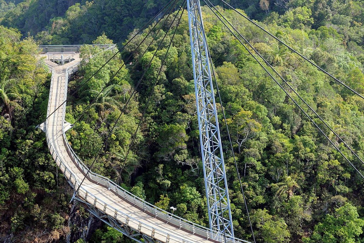 Langkawi Sky Bridge is a 125m curved pedestrian cable-stayed bridge in Malaysia at the top of the 500-million-year-old Mount Mat Cincang. At 1.8m wide, the bridge opened to tourists in 2005 and provides a 360 degree view of the Langkawi islands and