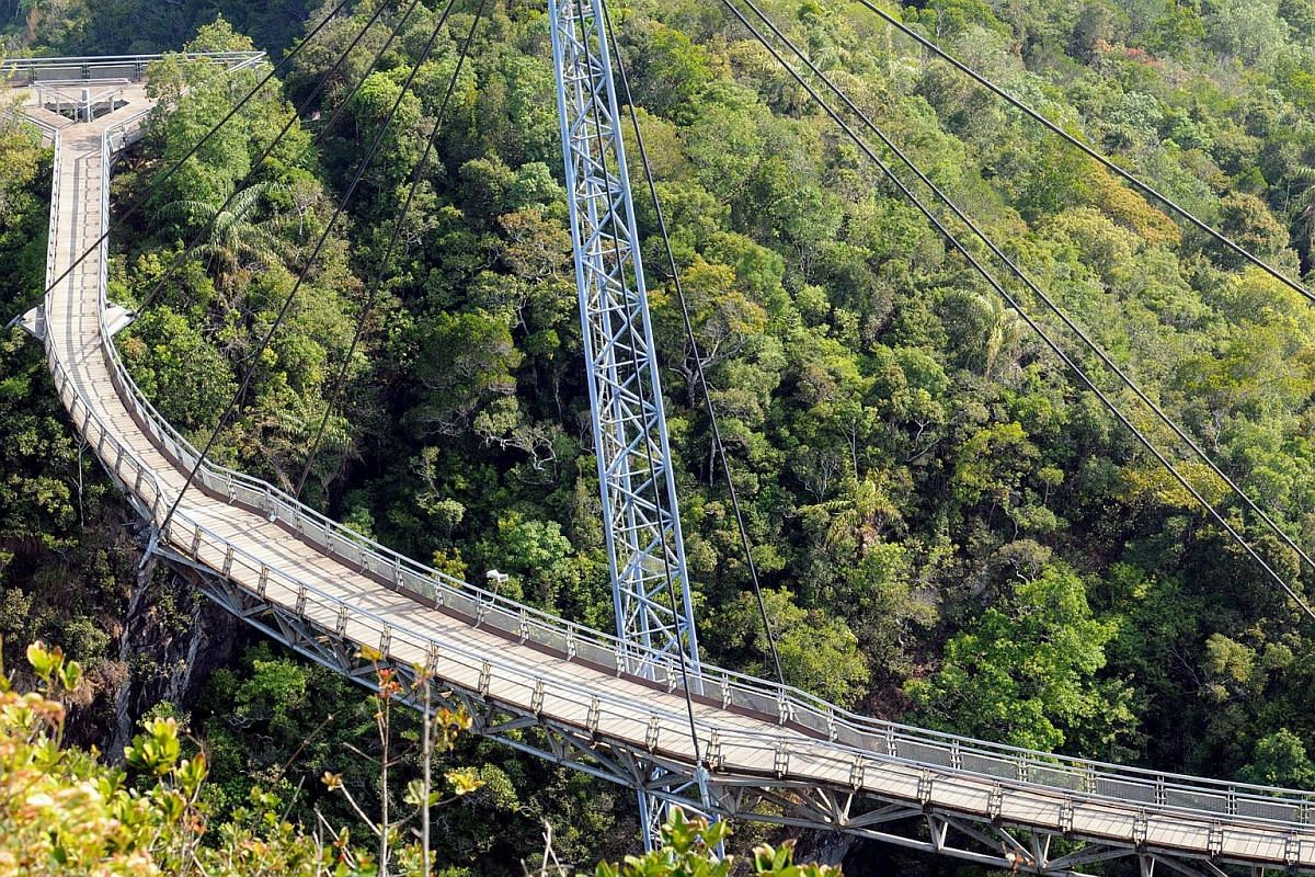 Located 2,300 feet  (701 metres) above sea level, the Sky Bridge can be accessed by the Langkawi Cable Car. The views on the way to the top of Langkawi's second-highest peak include those of the Telaga Tujuh Waterfalls and the rainforest.