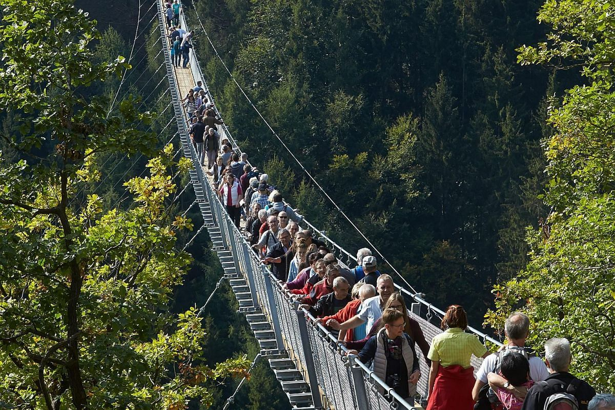 A new attraction in western Germany, the Geierlay rope suspension bridge above the Geierley canyon between Moersdorf and Sosberg is nearly 91m above a canyon floor. At nearly 366m in length, it is Germany's longest rope suspension bridge. Pictured ar