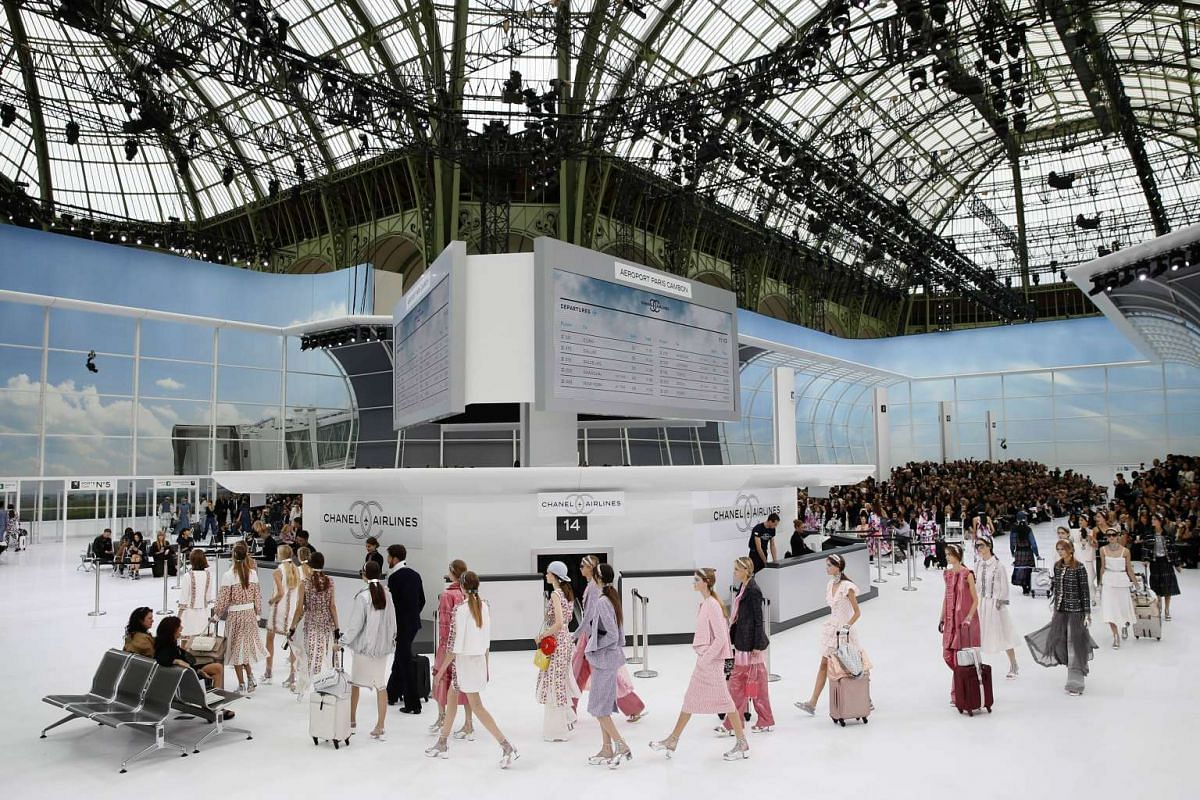 Models present creations for Chanel during the 2016 Spring/Summer ready-to-wear collection fashion show, on Oct 6, 2015 at the Grand Palais in Paris.