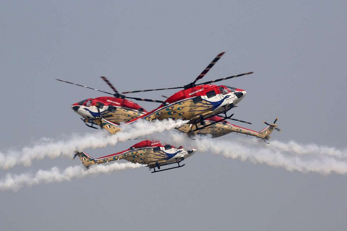 The Indian Air Force's 'Sarang' helicopters team show their aerobatics skills in a rehearsal for the Indian Air Force Day at the Hindon air force station outside New Delhi, India, 6 Oct 2015