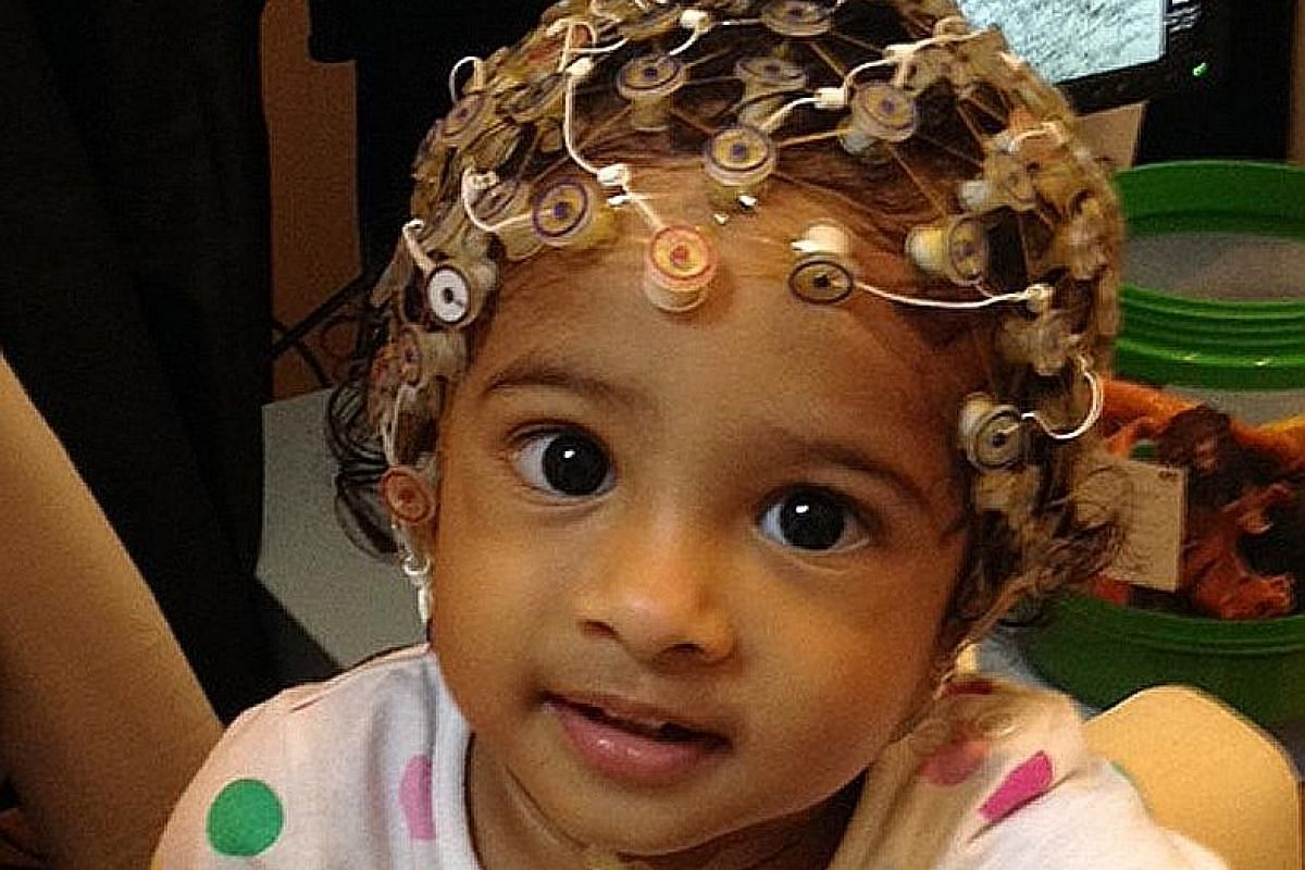A child performing cognitive tasks while the brainwaves are monitored and tracked.