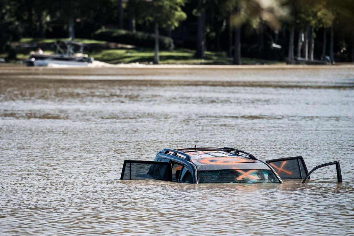 A car is submerged in Lake Katherine on Oct 6, 2015, in Columbia, South Carolina. The American state experienced record rainfall amounts over the weekend and officials expect the costs to be in the billions.