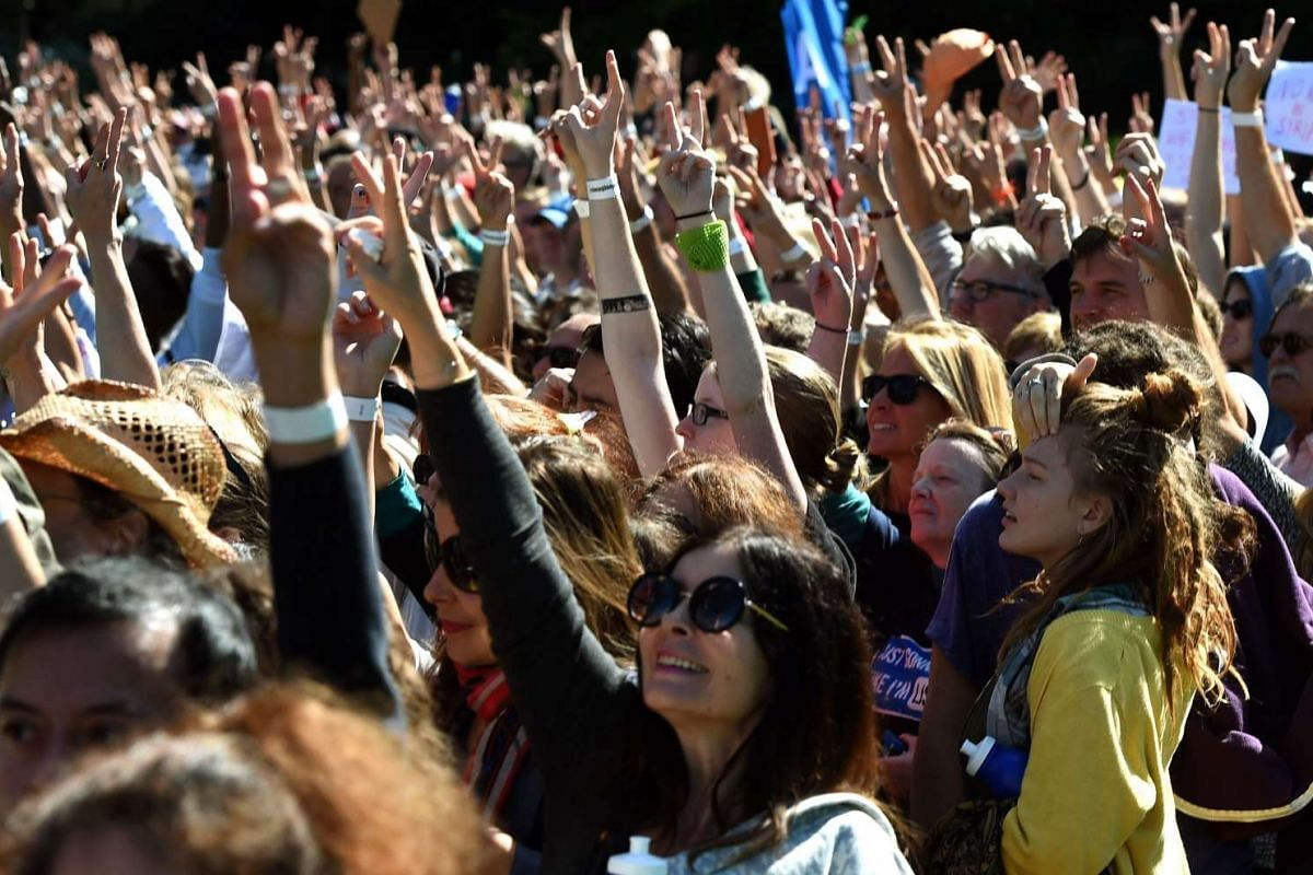 People gather in Central Park on Oct 6, 2015, in New York, US, to celebrate John Lennon's 75th birthday.