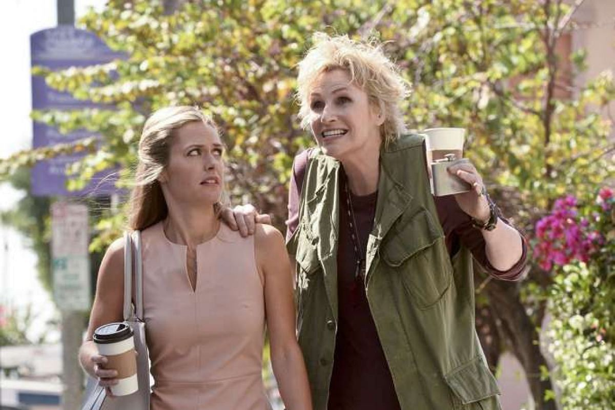 Amy (Jane Lynch, right) tries to convince Allison (Maggie Lawson) she is her guardian angel.