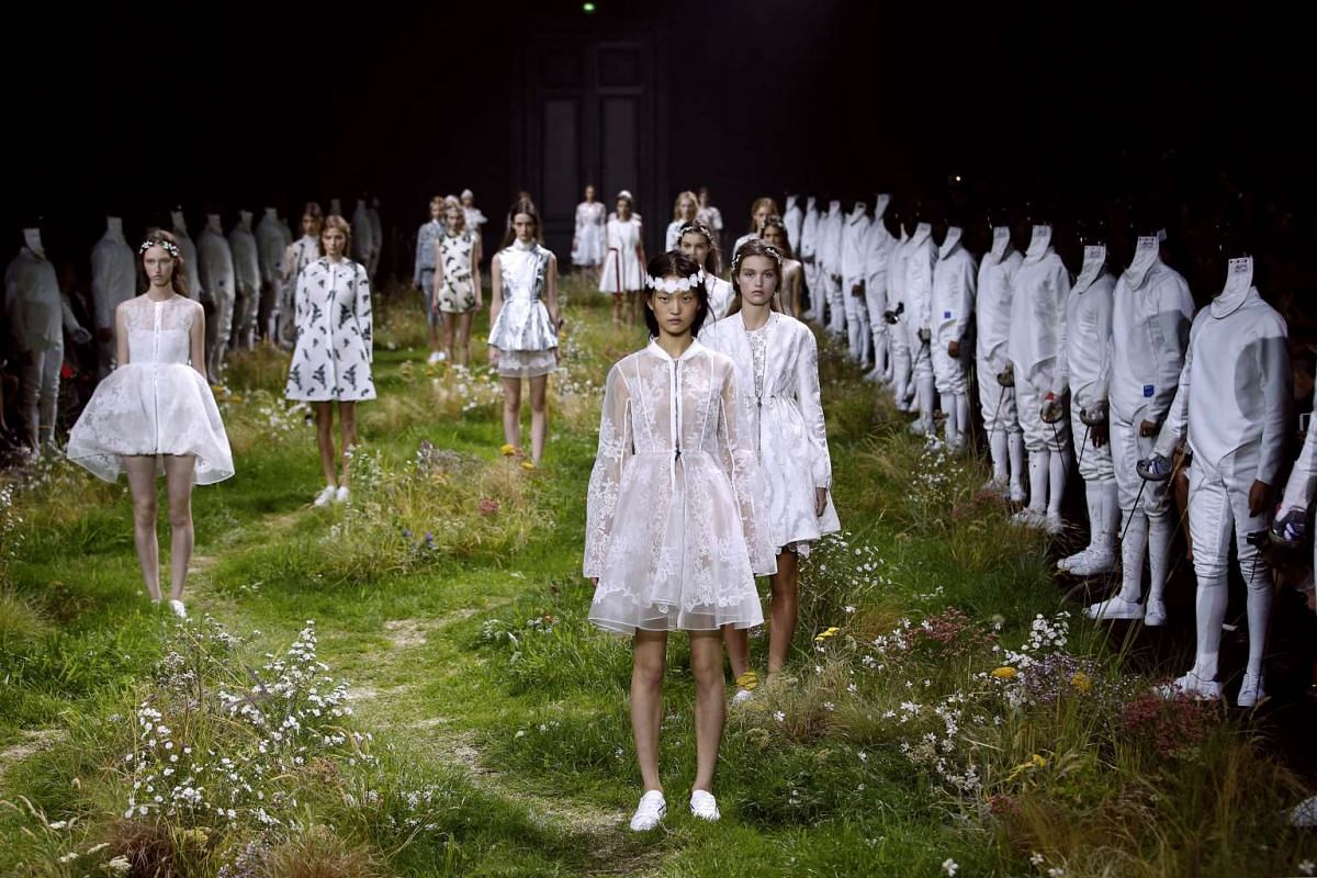 Models presenting creations for Moncler Gamme Rouge during the 2016 Spring/Summer ready-to-wear collection fashion show, on Oct 7, 2015, in Paris.