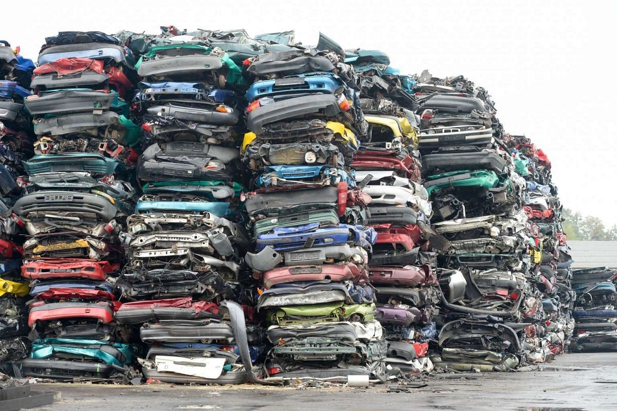 Compressed cars piled up in freight-friendly bales of scrap awaiting their transport on Oct 6, 2015, on the grounds of a car recycling company in Krostitz, eastern Germany.