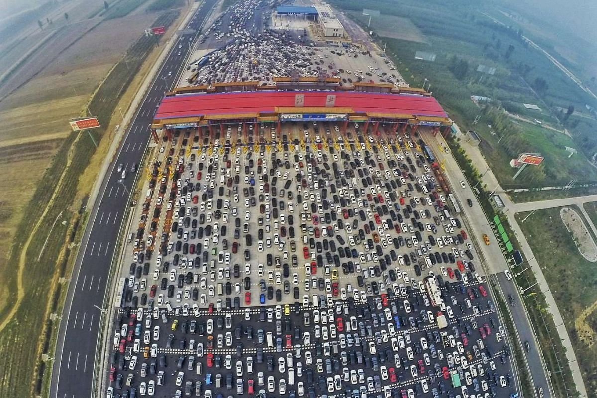 Vehicles stuck in a traffic jam near a toll station as people return home at the end of a week-long national day holiday, in Beijing, China, on Oct 6, 2015.