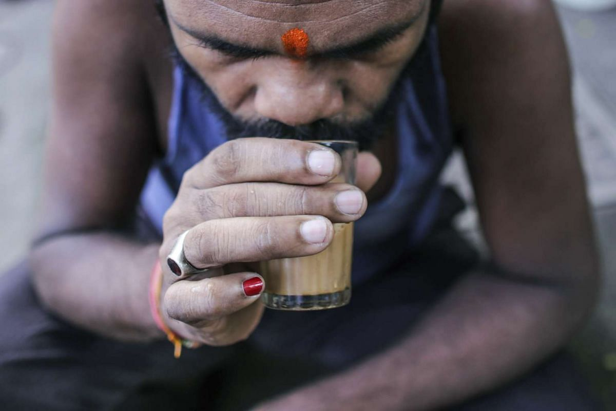A customer sipping a glass of chai at a roadside stall in Mumbai, India. Chai, the sweet, milky tea concoction popular in South Asia, is getting an image makeover in India. Rising incomes and demand for a refined tea experience transcending chai are