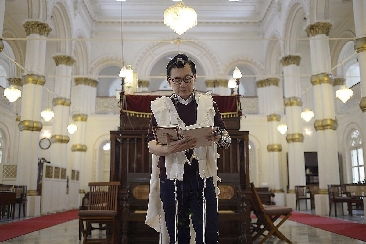 Radio producer and presenter Andrew Lim at the Chesed-El Synagogue in Oxley Rise. The 48-year-old, whose wife and three children are also Orthodox Jews, said the teachings of the faith resonate strongly with him.