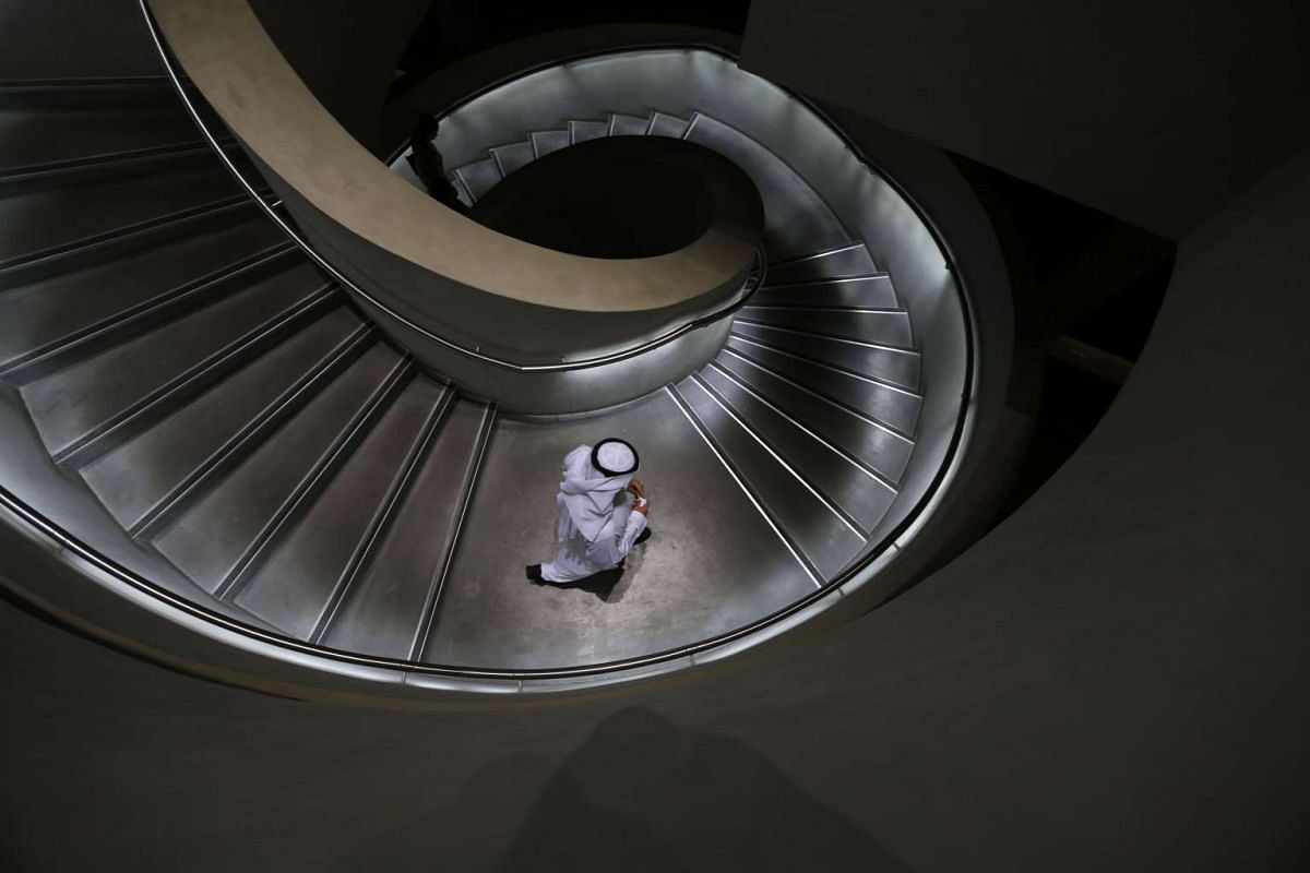 An Emirati man walks down stairs in Masdar City, on the outskirts of the rich Emirate of Abu Dhabi, on Oct 7, 2015. Masdar City is a high-density, pedestrian-friendly development where current and future renewable energy and clean technologies are sh