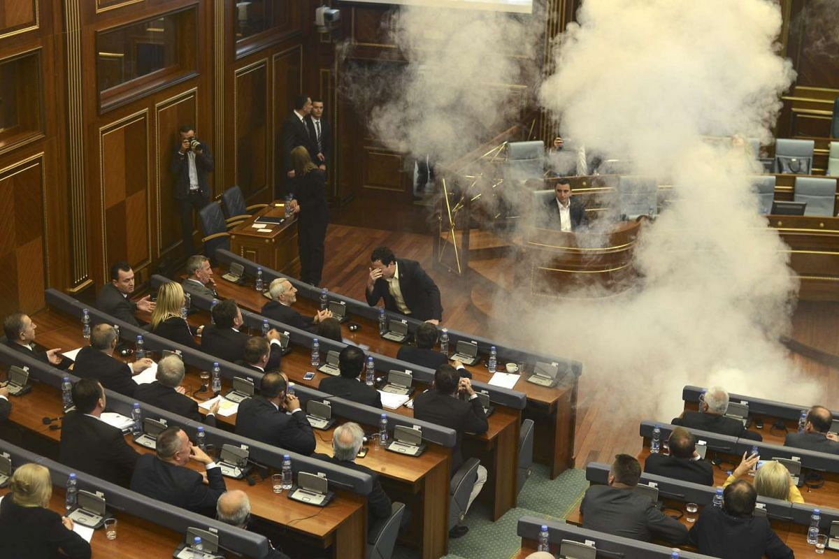 Opposition lawmakers throw tear gas during a session of Kosovo's parliament in Pristina, Kosovo Oct 8,2015. Kosovo's opposition political parties protest against the agreements that has been reached during the EU-brokered dialogue with Serbia.