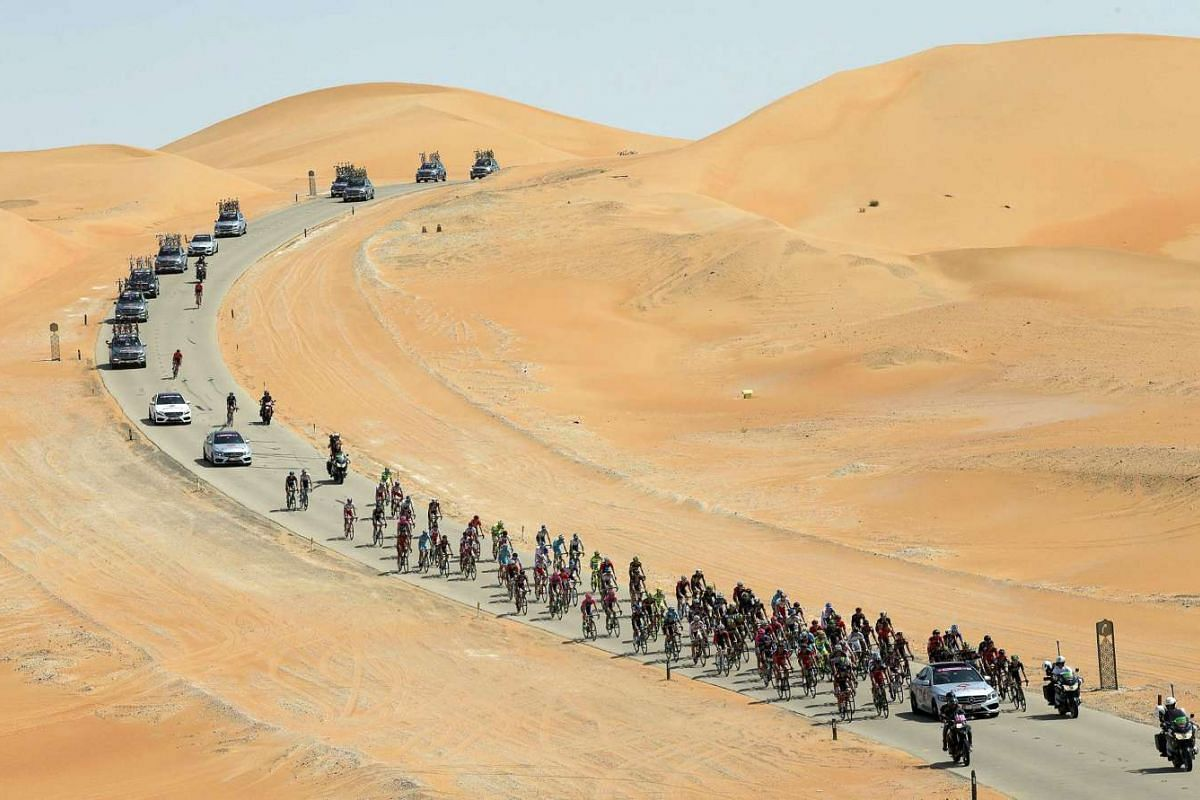 The pack is on the way during the first stage of the Abu Dhabi Tour cycling race over 160km from Qasr Al Sarab to Madinat Zayed, United Arab Emirates, Oct 8, 2015.