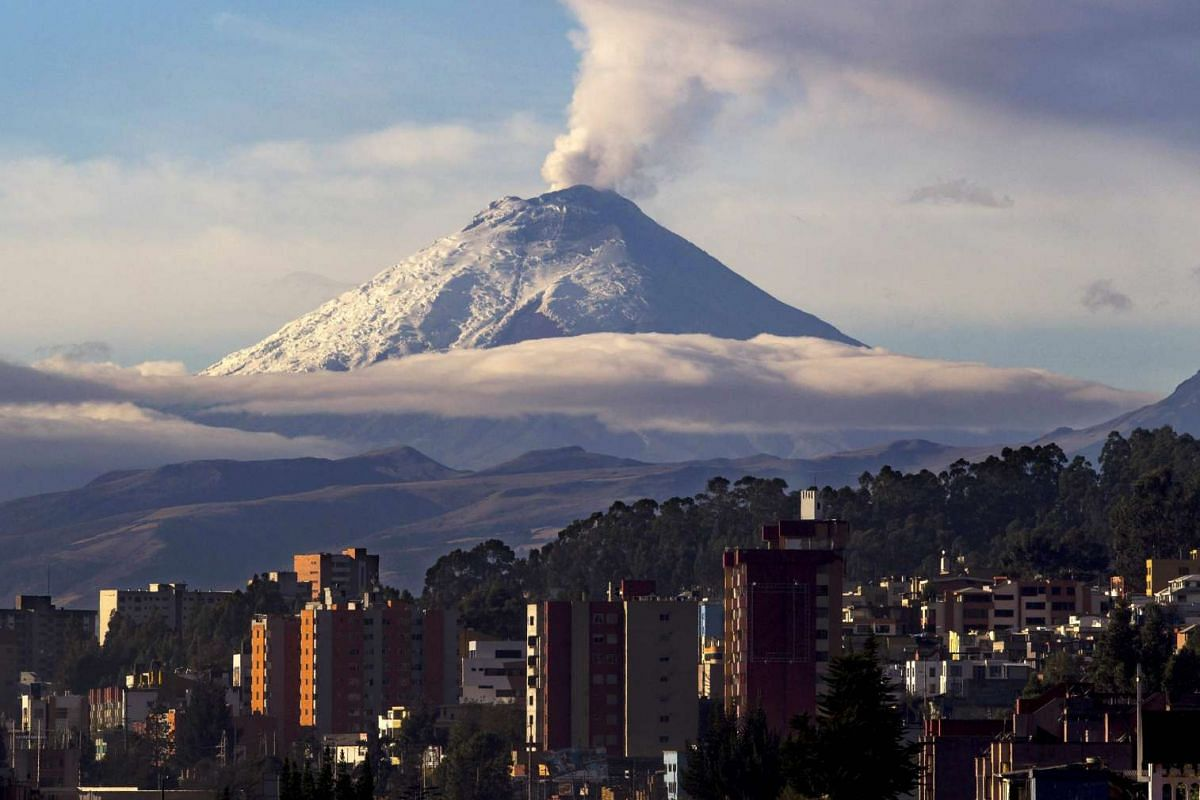 Cotopaxi volcano spews ash and steam near Quito, Ecuador, Oct 8 2015. The Security Coordinator Ministry, based on reports from the Geophysical Institute (IG) of the National Polytechnic School, said that Cotopaxi volcano 'continues its moderate inter