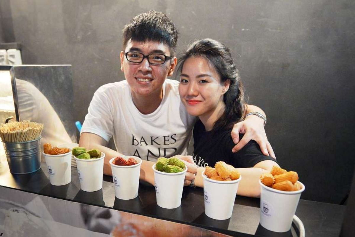Dating couple Tan Zi Yao and and Crystal Cheng sell either churros or macarons at events.