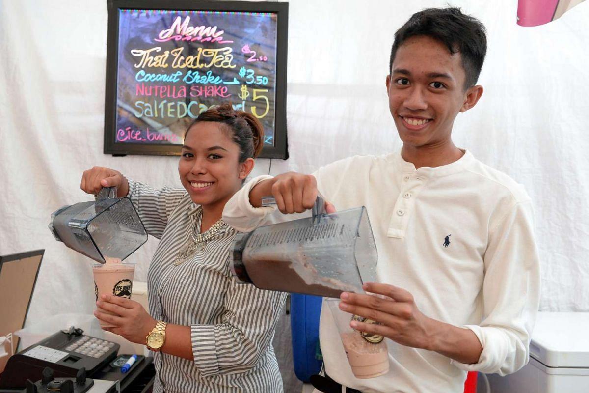 Ms Miza Nazili and her cousin, Mr Amirul Amsyar, sell their iced beverage creations at pasar malams.