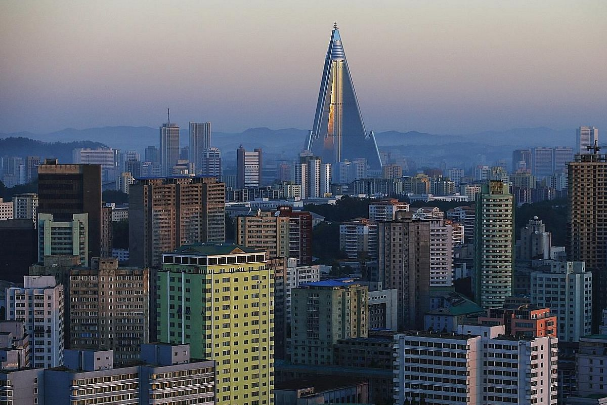 The 105-storey Ryugyong Hotel, the highest building under construction in North Korea, is situated behind residential buildings in Pyongyang.