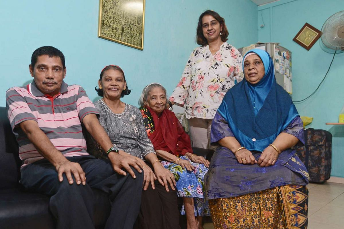 Madam Atika Bibi Mohammad Ismail (in blue) takes care of her half-siblings Abdul Seram Mohammad Shariff and Alimah Mohammad Shariff and her mother Peer Mohamed Patamah Beebe. With her is her daughter Jamila Mustaffa, who visits once a week.
