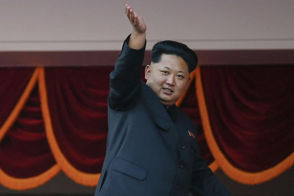 North Korean leader Kim Jong Un waving to the crowd at a parade celebrating the 70th anniversary of the founding of the ruling Workers' Party of Korea in Pyongyang on Oct  10, 2015.