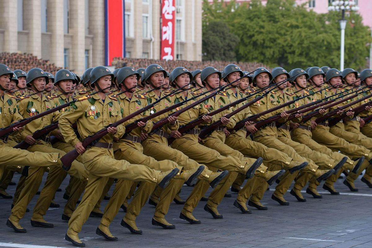 North Korean soldiers marching at a mass military parade at Kim Il Sung Square in Pyongyang on Oct 10, 2015.