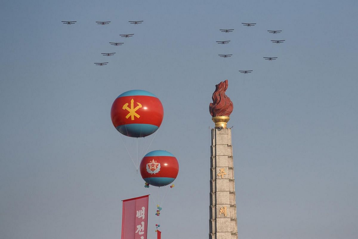 Aircraft performing a flypast over the Juche tower at Kim Il Sung Square in Pyongyang on Oct 10, 2015.
