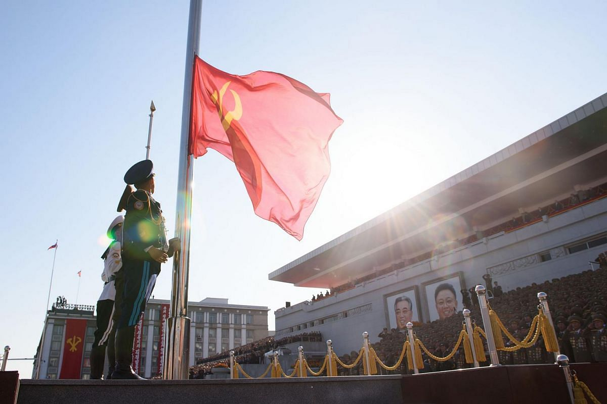 North Korean soldiers hoisting a flag at the start of a mass military parade at Kim Il Sung Square in Pyongyang on Oct 10, 2015.