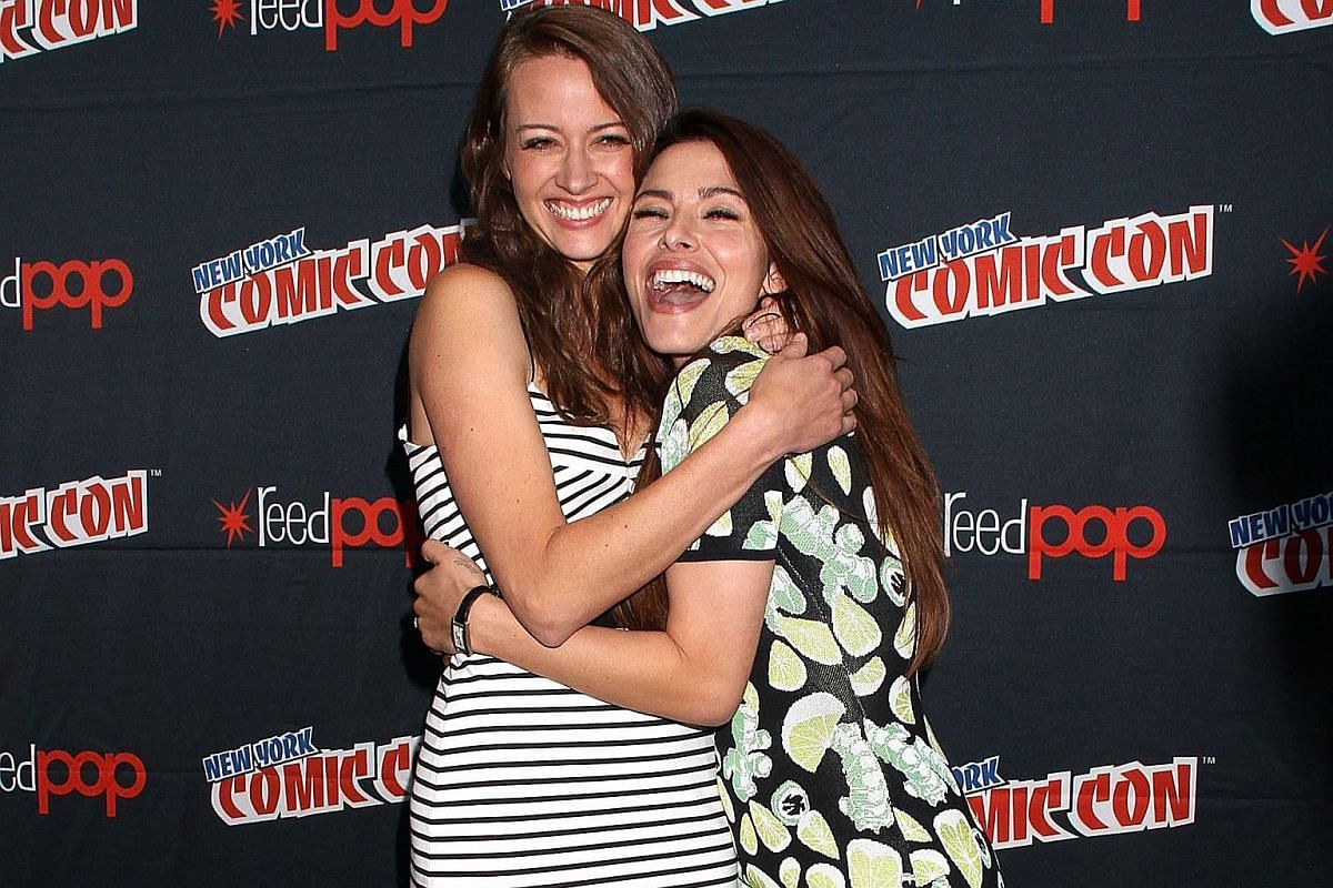 Amy Acker and Sarah Shahi, stars of Person Of Interest at the New York Comic Con 2015 - Day 4 at The Jacob K. Javits Convention Center on Oct 11, 2015, in New York City.