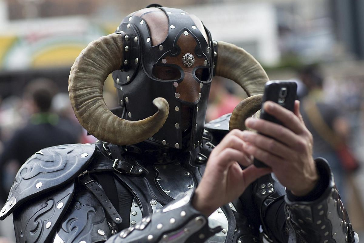 A man in costume using his cellphone on Day 2 of New York Comic Con in Manhattan, New York, on Oct 9, 2015.