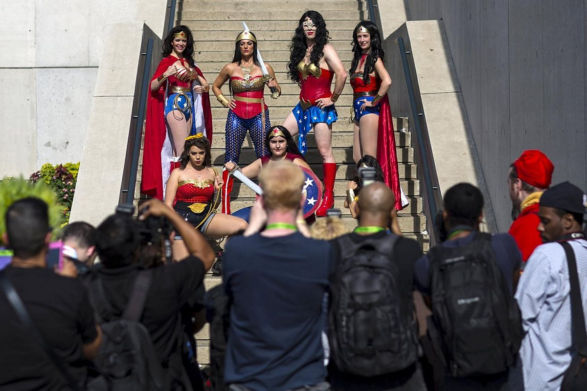 A group of people dressed as Wonder Woman posing for photographers on Day 2 of New York Comic Con in Manhattan, New York, on Oct 9, 2015.