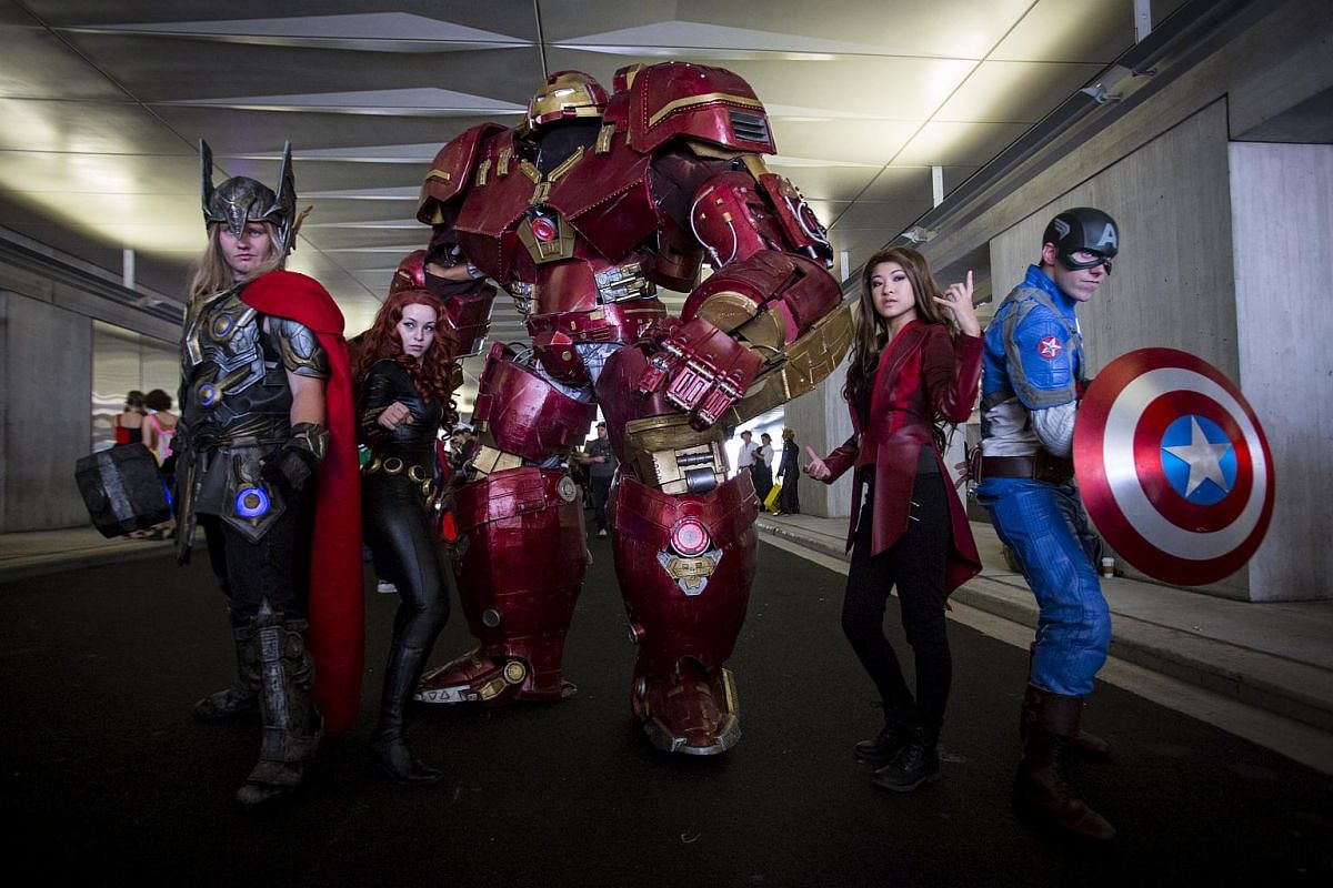 People dressed as (from left) Thor, Black Widow, Hulkbuster, Scarlet Witch and Captain America posing for photos on Day 2 of New York Comic Con in Manhattan, New York, on Oct 9, 2015.