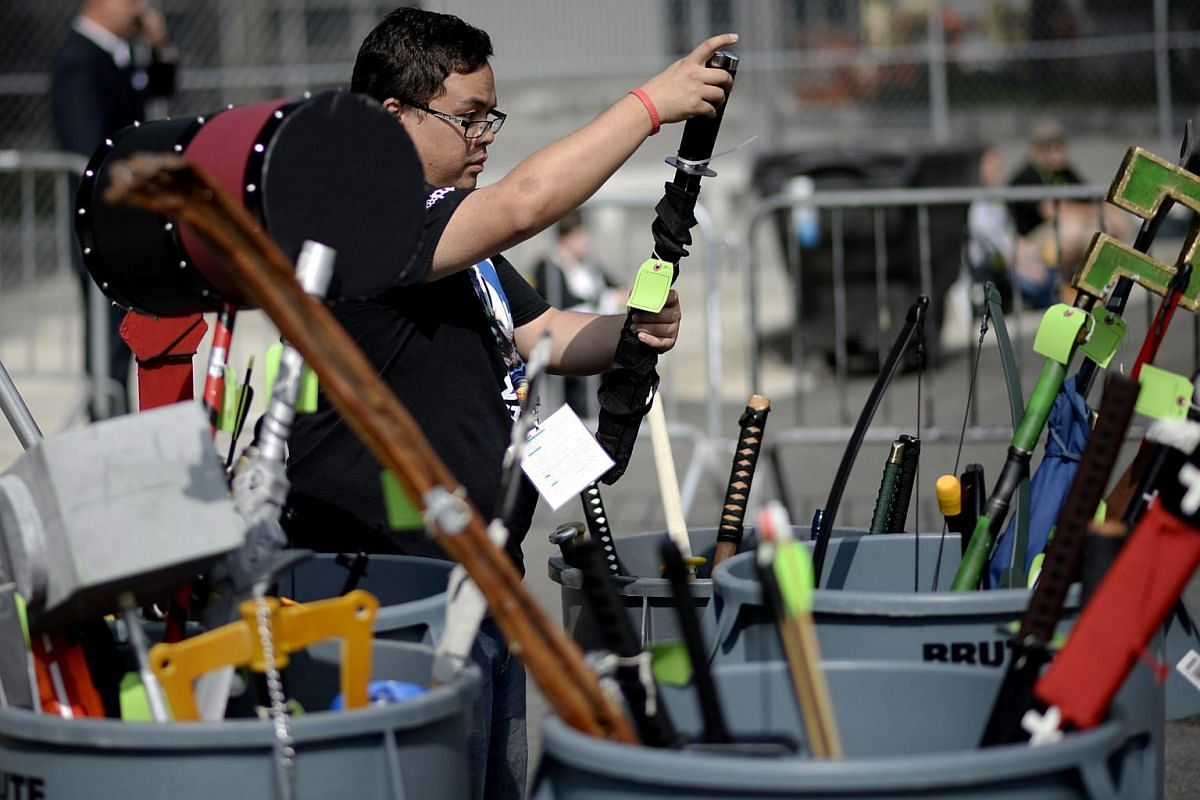 A member of the staff reorganising a variety of confiscated weapons brought by fans at the 2015 New York Comic Con at the Jacob K. Javits Convention Center in New York, New York, on Oct 8, 2015.
