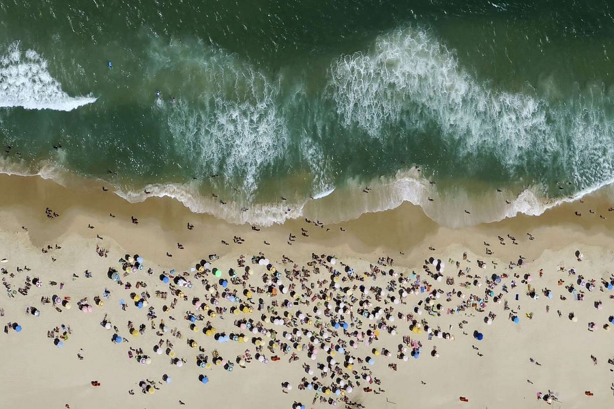 People out enjoying the sunny weather at Ipanema beach in Rio de Janeiro, Brazil, on Oct 10, 2015.