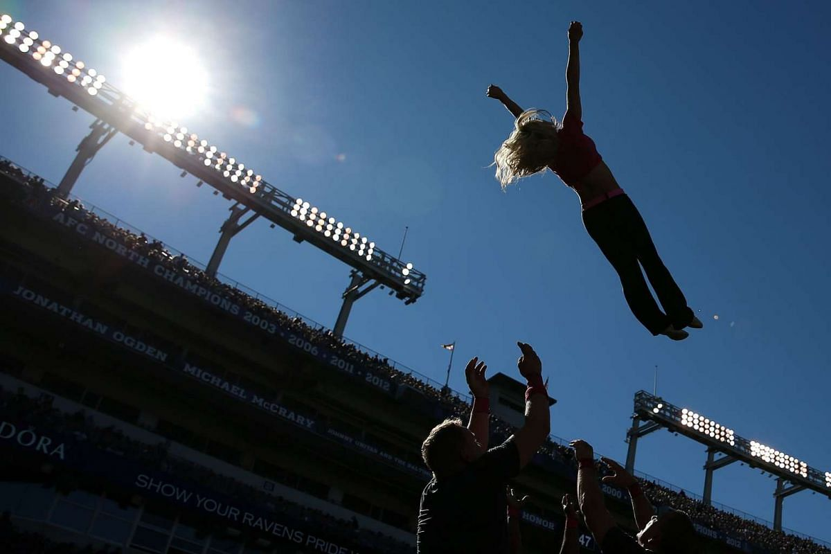 Baltimore Ravens cheerleaders performing on the sideline during the second quarter of a game between the Baltimore Ravens and the Cleveland Browns at M&T Bank Stadium on Oct 11, 2015, in Baltimore, Maryland.