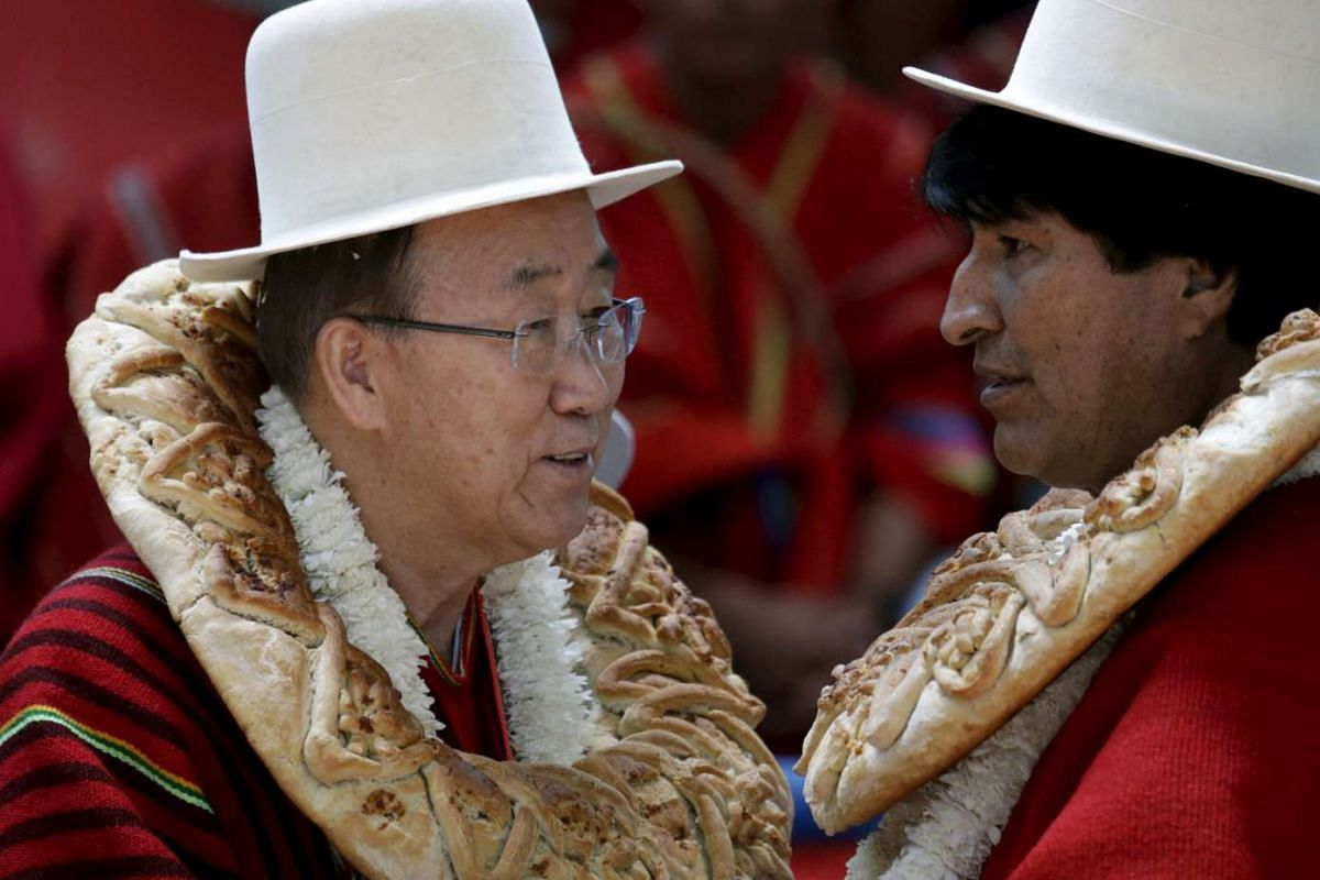 """UN Secretary-General Ban Ki-moon (left) with Bolivia's President Evo Morales during the inauguration of a sports arena called """"Coliseo Ban Ki-Moon"""" in Vila Vila, south of Cochabamba, on Oct 11, 2015. Ban is in Bolivia for the World People's Conferenc"""