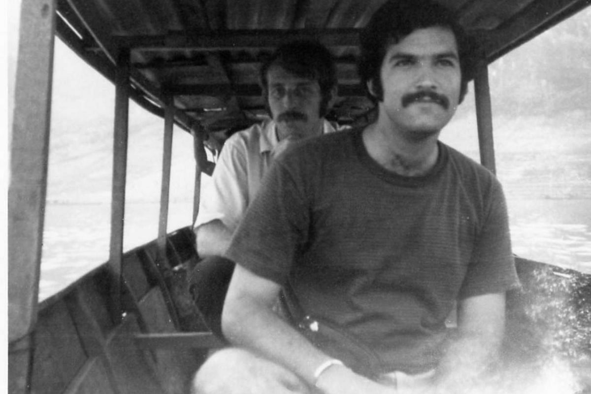 Mark Eldeson with his friend Raphael Pura (background) crossing the Mekong in 1970