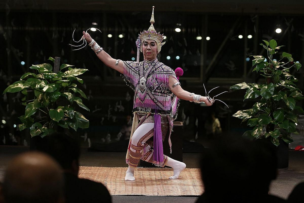 Performance of Nora (above), a type of traditional dance in Thailand.
