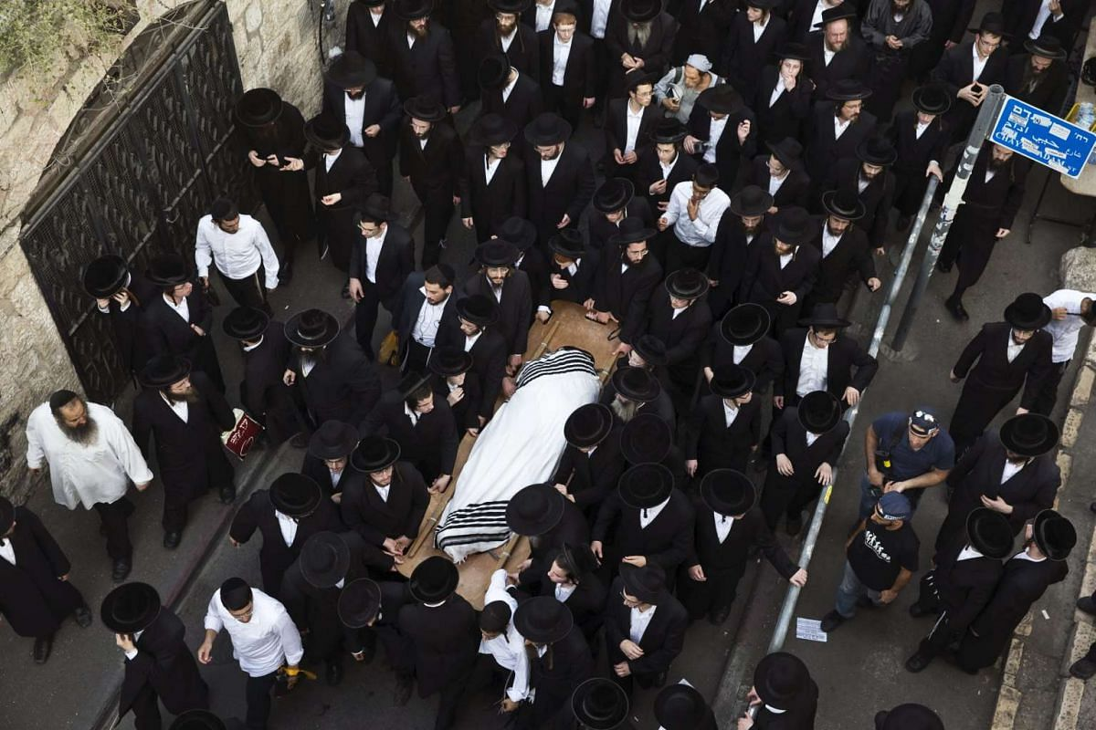 Ultra-Orthodox Jews carrying the body of Yeshayahu Krishevsky during his funeral in Jerusalem's Mea Shearim neighbourhood on Oct 13, 2015. He was one of three Israelis killed in stabbing attacks in Jerusalem on Oct 13.
