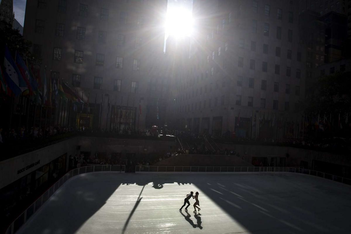 Olympic gold medal ice dancers Meryl Davis (right) and Charlie White skate on The Rink at Rockefeller Center, the first skaters to kick off the winter season with the rink now open to the public in the Manhattan borough of New York on Oct 13, 2015.