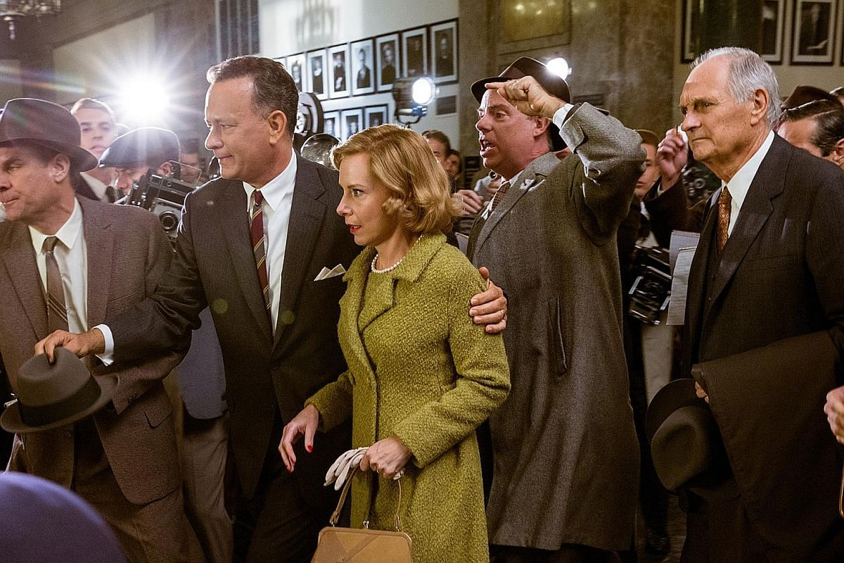 In Bridge Of Spies, Tom Hanks (above second from left) plays lawyer James B. Donovan, who is hired to negotiate for the release of a captured American pilot.