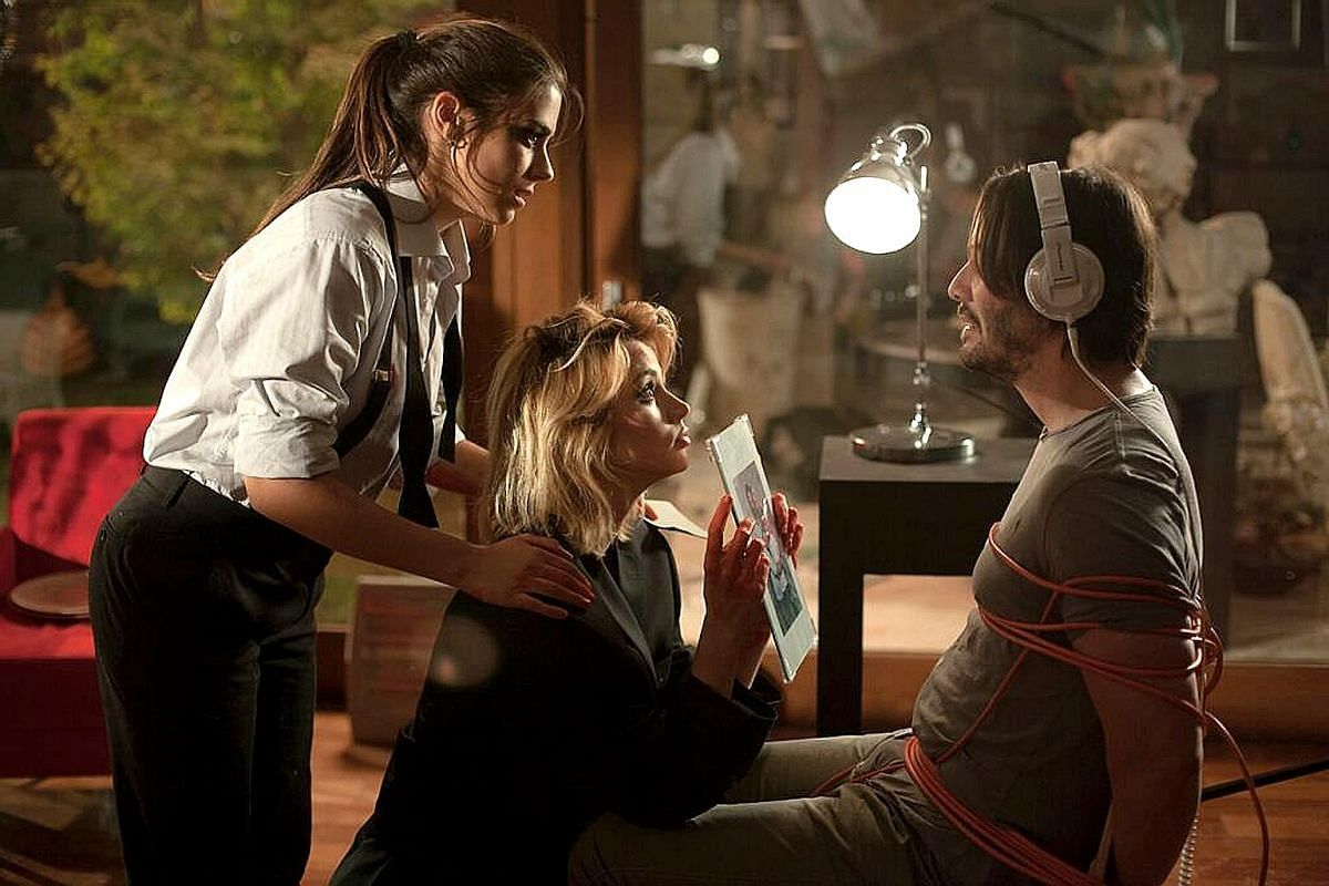 In Knock Knock, Keanu Reeves (right) stars as Evan, a family man who is terrorised by two women Genesis (Lorenza Izzo) and Bel (Ana de Armas, centre).