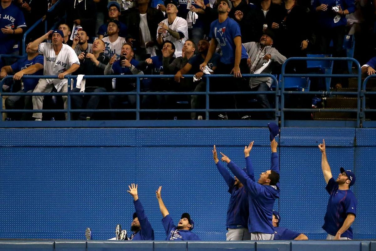 The Texas Rangers bullpen reacting to a solo home run hit by teammate Shin-Soo Choo #17 of the Texas Rangers in the third inning against the Toronto Blue Jays in game five of the American League Division Series at Rogers Centre on Oct 14, 2015, in To