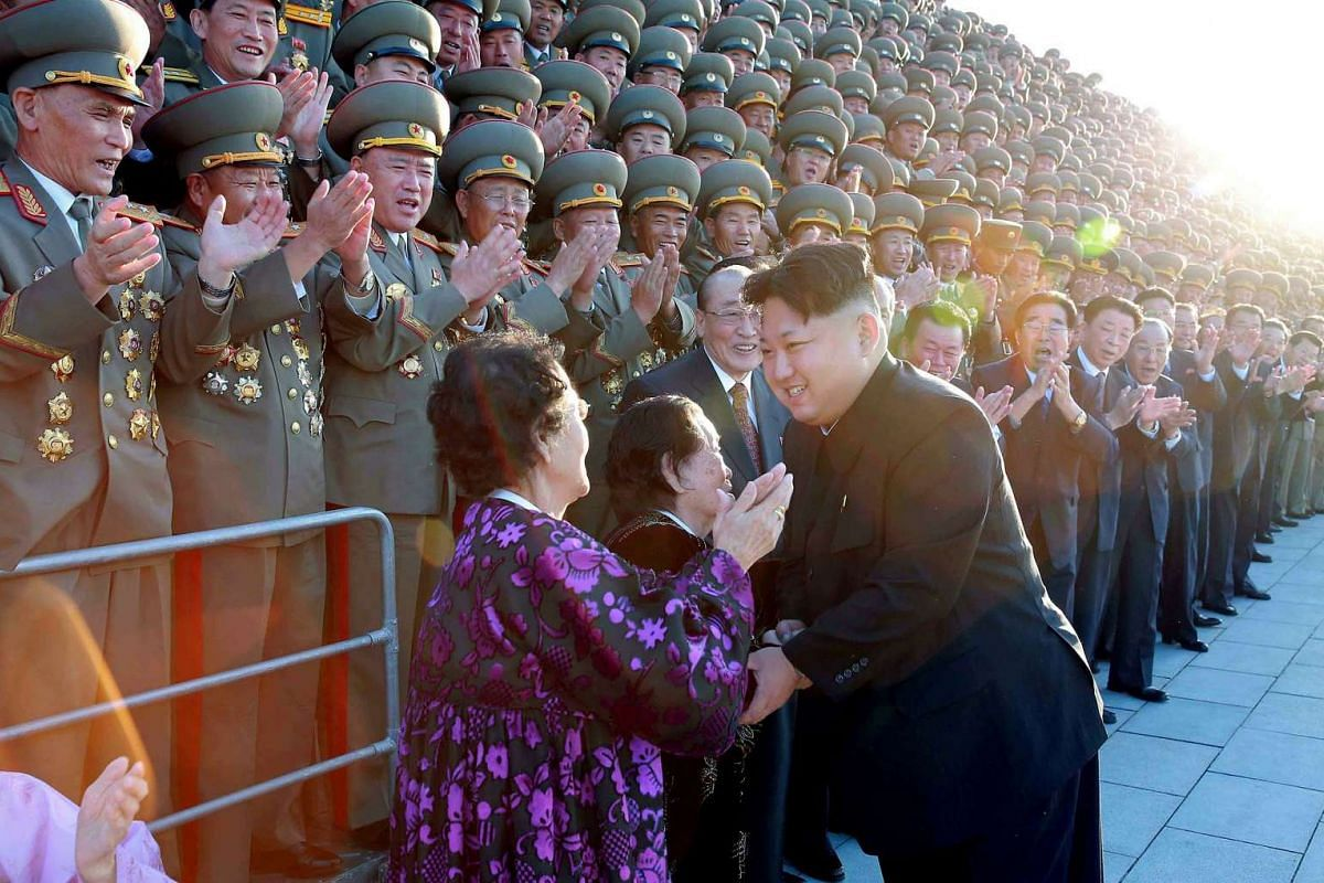 This undated photo released by North Korea's official Korean Central News Agency (KCNA) on Oct 15, 2015, showing North Korean leader Kim Jong-Un shaking hands with representatives from local areas to celebrate the 70th anniversary of its ruling Worke