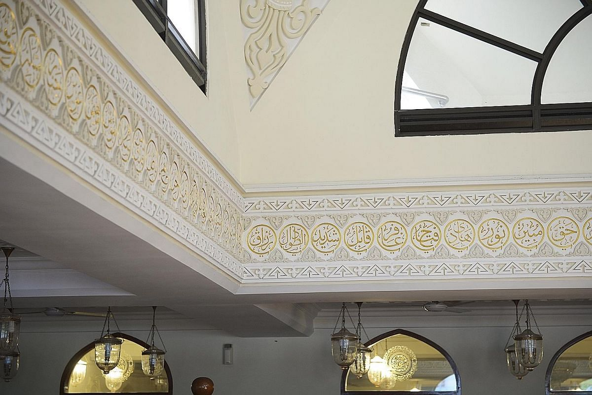 (Above): Gilded inscriptions of the different names of Allah adorn the Masjid al Burhani in Hill Street. The prayer hall consists of two floors - the upper storey for the women and the ground floor for the men. (Right): Men from the Dawoodi Bohra com