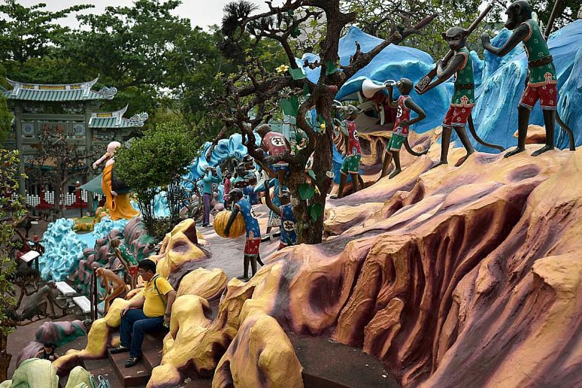 A visitor posing for a snapshot at Haw Par Villa on Oct 4, 2015.
