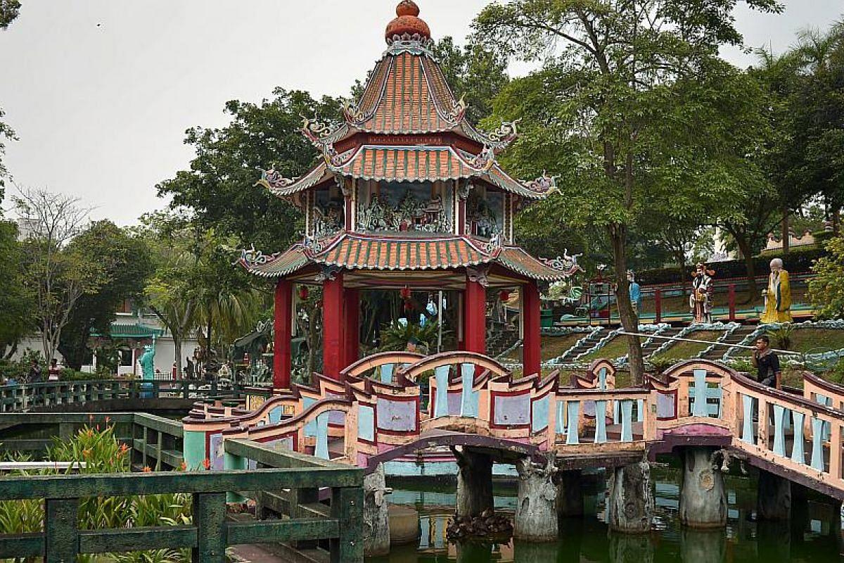 A pagoda over water at Haw Par Villa.