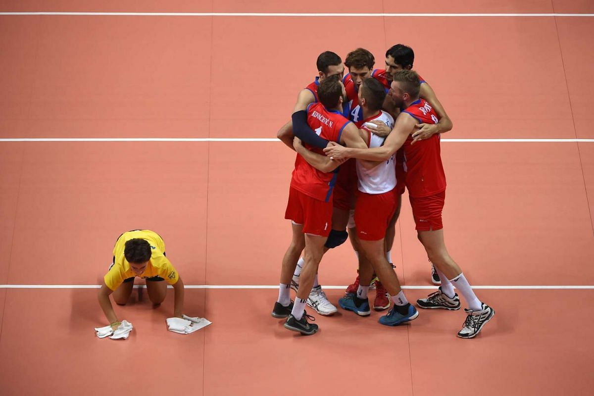 Serbia's players celebrating during their quarter final volleyball match France vs Serbia at the Men Volleyball European Championships in Busto Arsizio on Oct 14, 2015.