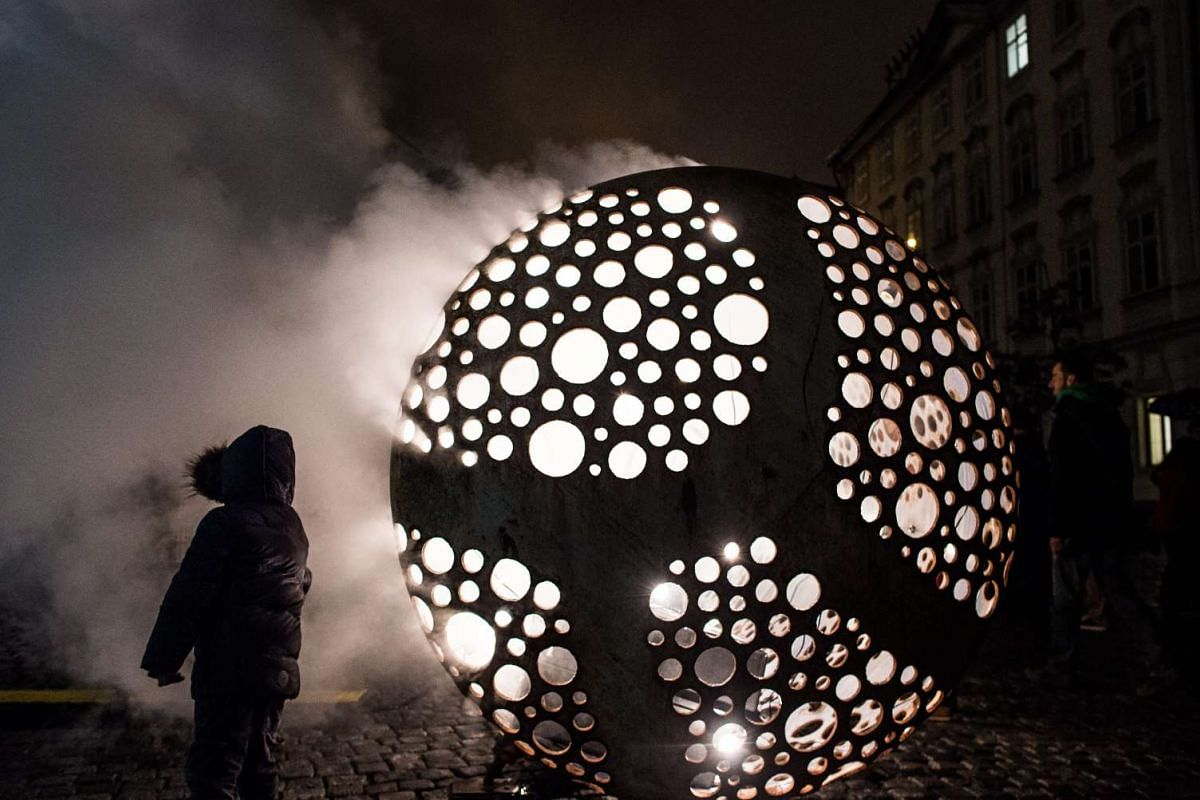 A young visitor passing by the light installation Ocelot by Cestmir Suska and Petr Pufler from Czech Republic during the Signal Festival in Prague, Czech Republic, on Oct 15, 2015. The festival features international and local artists presenting new