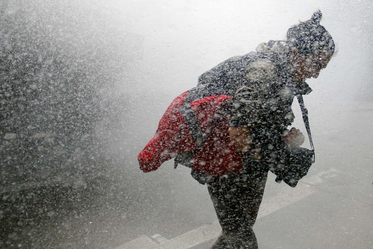 A student is hit by a water cannon during a march called by the Confederation of Chilean Students (Confech) to reject the changes announced by the government to an education Bill, in Santiago, Chile, on Oct 15, 2015.