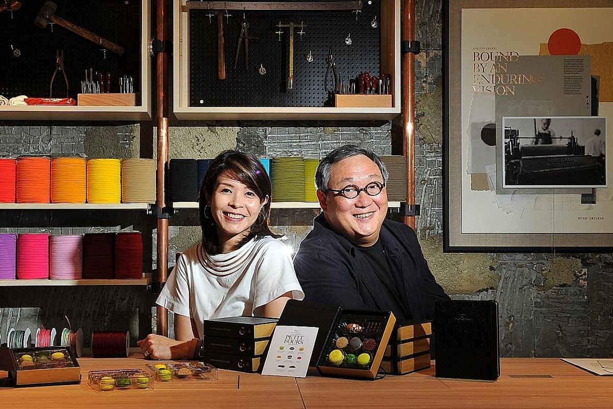 Ms Winnie Chan (right), founder of a bookbinding company, and restaurateur Ignatius Chan (far right), who is also her uncle, collaborated to create a set of petit fours, sold at the Bynd Artisan atelier in Chip Bee Gardens, Holland Village. Plain Van